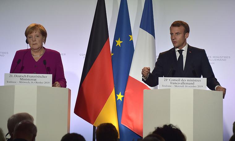 Macron ve Merkel'den Türkiye açıklaması: 'AB ülkelerinin Türkiye'ye yaptığı silah ihracatlarını durdurmasını sağladık'