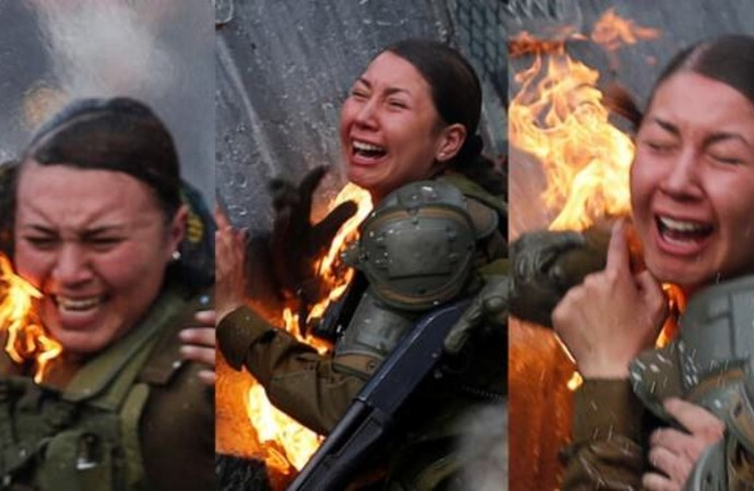 Şili'deki eylemlerde, protestocular molotof atarak polisleri ateşe verdi: İşte o anlar