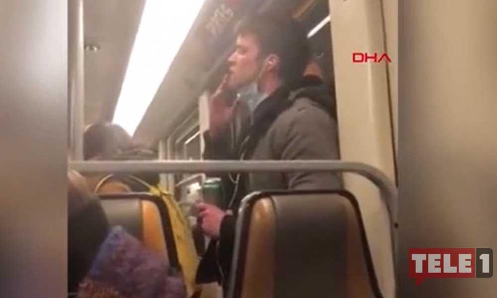Maskeli yolcu, ağzına götürdüğü elini defalarca metronun tutunma borusuna sürdü