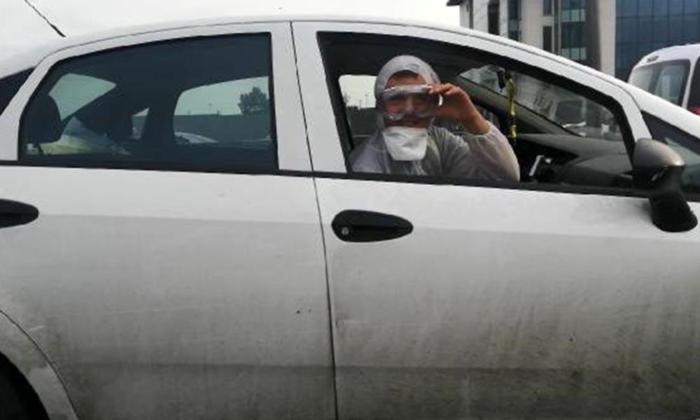 Görüntü İstanbul'un ortasından! Tulum giyip maske ve gözlük takarak trafiğe çıktılar