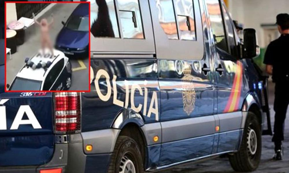 İspanya'da şok protesto! Polis aracının üzerine çıktı ve soyundu