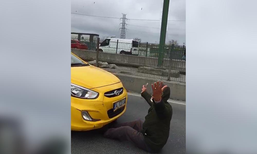 Sultangazi'de içinde gelinini gördüğü taksinin önüne yattı