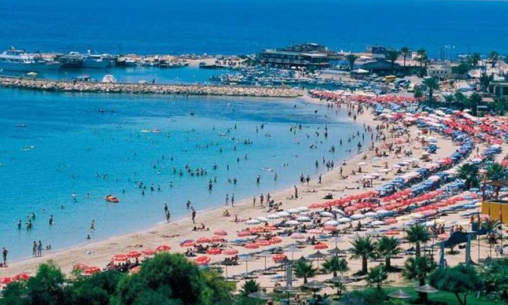 Güney Kıbrıs, tatil sonrası koronavirüse yakalananların masraflarını karşılayacak