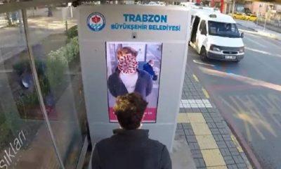 Maske takmayanların yüzünü 'koronavirüse dönüştüren' ekran