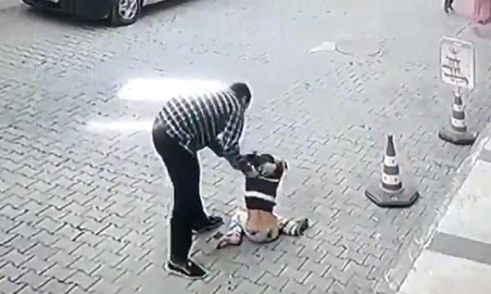 Bir çocuğu sokak ortasında yere vurarak döven Mahmut A. tutuklandı