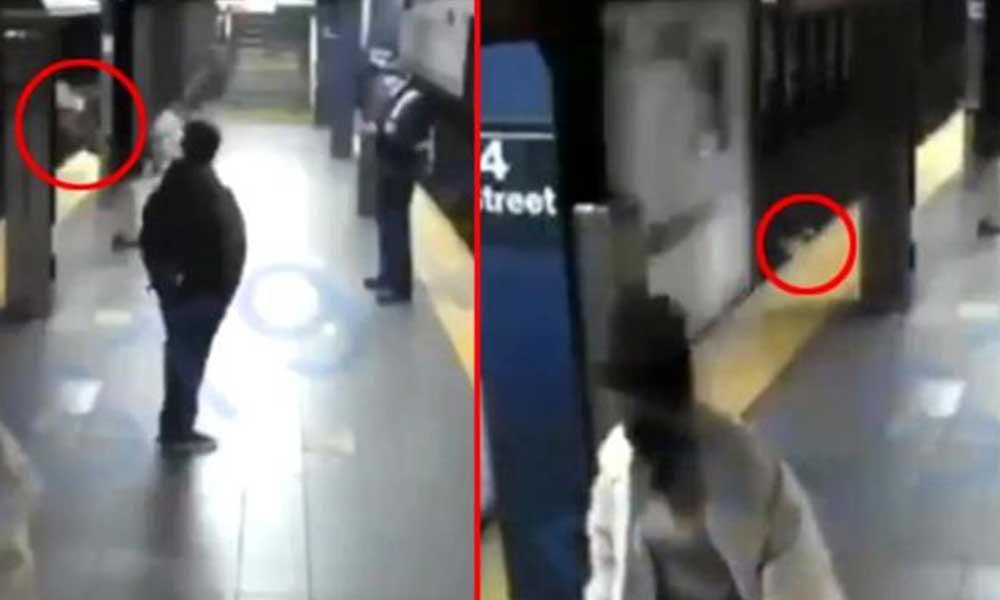 Tren bekleyen kadını rayların altına itti
