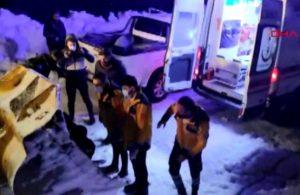Kar yağışı nedeniyle köy yolu kapandı, kepçe ağzında ambulansa taşındı!