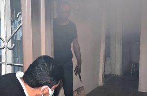 Evini ateşe verdi, gelen itfaiyeye bıçak çekti