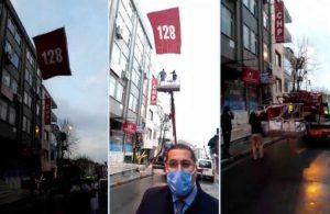 Polisler '128' yazılı afişi de söktü
