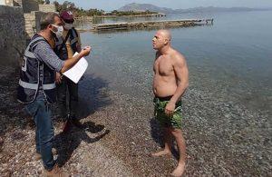 Datça'da yabancı turistleri görüp denize giren yurttaşa ceza kesildi