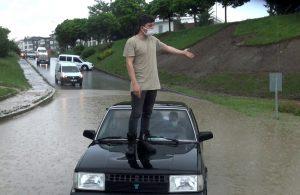 Trafik polisi aracın üzerine çıkarak uyarı yaptı