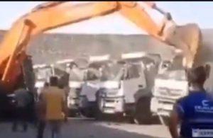 Parasını alamayan işçi kamyonları parçaladı