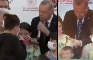 Erdoğan kurdele kesiminde çocuğu, kafasına vurarak uyardı
